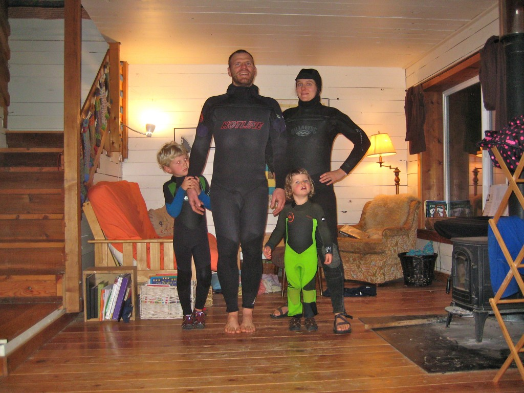 And, later, we all donned wetsuits to go play around in the rising flood waters on our lowest field. The kids got pulled around on Casey's surfboard. Fun was had by all.