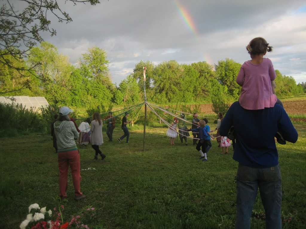 Dottie watches the May pole dance from atop Casey's shoulders.