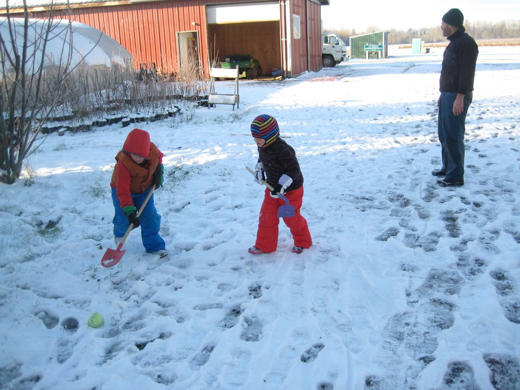 Casey invented a new game to play during morning P.E.: farm snow hockey!